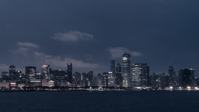 t/l pan chicago skyline at dawn, night to day transition / chicago, illinois - dawn to day stock videos & royalty-free footage