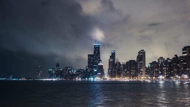 t/l chicago skyline at night in fog / illinois, us - chicago loop stock videos and b-roll footage