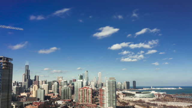 Chicago skyline during daytime, clouds and shadows move across sky and city.