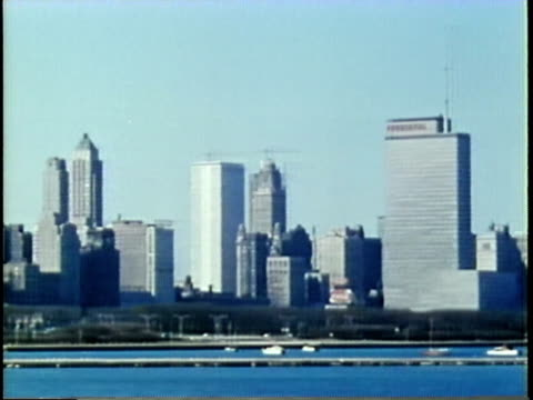 stockvideo's en b-roll-footage met 1963 montage dissolve pan chicago skyline from lake michigan/ lake shore drive / chicago, united states / audio - 1963
