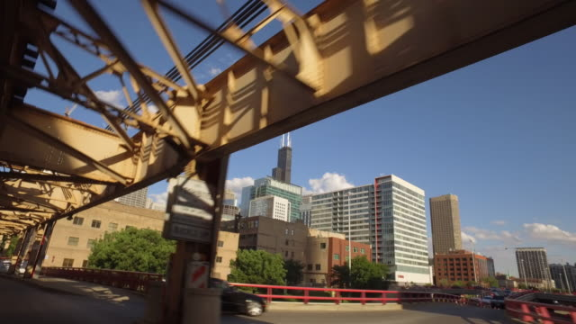 "chicago skyline from under ""l"" elevated train line - chicago 'l' stock videos & royalty-free footage"