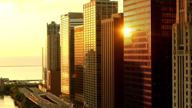chicago skyline sunrise - skyscraper stock videos & royalty-free footage