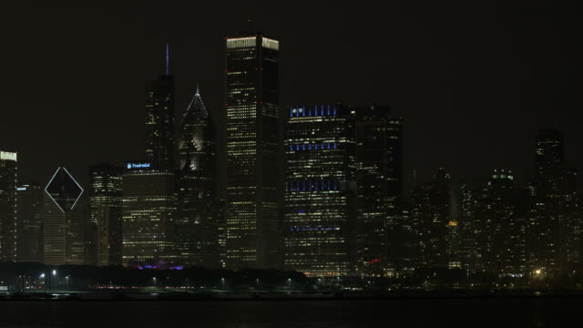 ws chicago skyline with lake night - waterfront stock videos & royalty-free footage