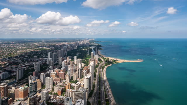 t/l ws ha zo chicago skyscrapers and lake michigan / chicago, usa - lago michigan video stock e b–roll