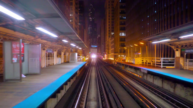chicago subway cart coming to the station. trump building. concept - chicago illinois stock videos & royalty-free footage