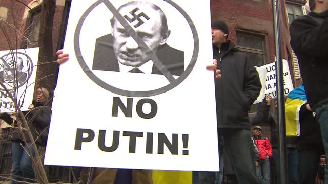 chicagoans protesting russia's actions in crimea outside the ukrainian consulate on march 22 2014 in chicago illinois - ukraine stock videos & royalty-free footage