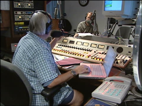 chicagobased radio talk show host steve dahl in recording booth during radio show for wckg radio station - dahl stock videos and b-roll footage