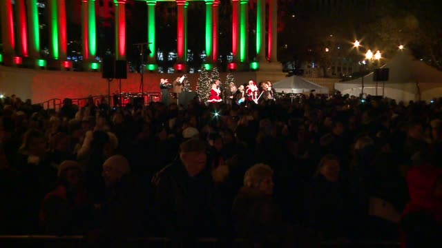 wgn chicago's 102nd annual tree lighting ceremony in millenium park on november 24 2015 - christmas tree lighting ceremony stock videos & royalty-free footage