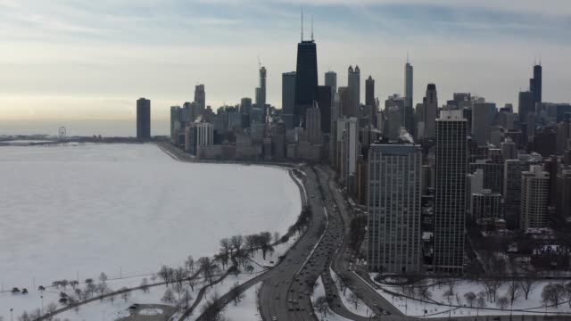 chicago's lake shore drive aerial with skyline - chicago illinois stock videos & royalty-free footage