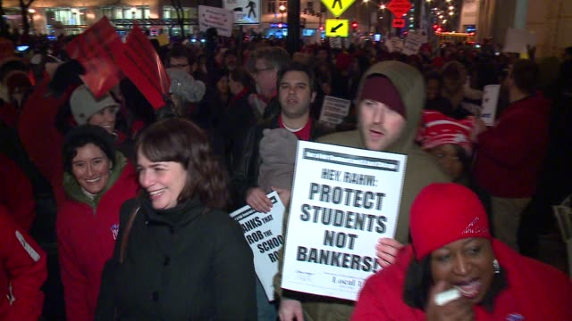 wgn chicago's teachers union rallied to protest proposed layoffs up to 1000 teachers as well as $725 million chicago public schools borrowed from... - bank of america stock videos & royalty-free footage