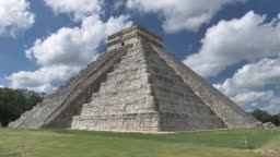 chichen itza with moving clouds