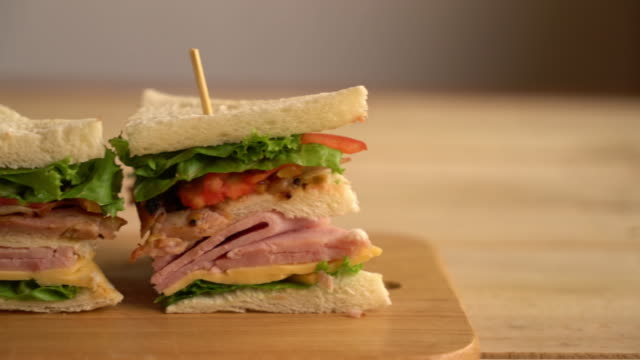 chiciken and ham sandwich on table