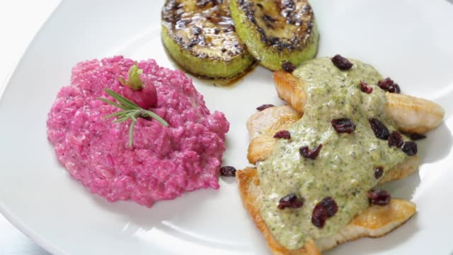 chicken breasts with red beet risotto and zucchini - risotto stock videos & royalty-free footage