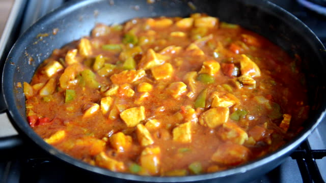 Chicken Curry Cooking in Pan