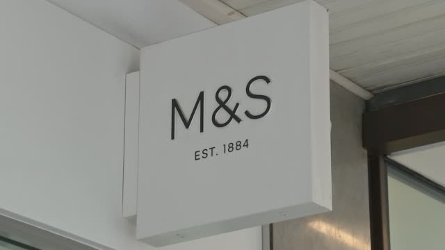 three supermarkets to suspend taking chicken from 2 Sisters factory Unidentified Location EXT 'Marks and Spencer' sign outside shop Entrance of Marks...
