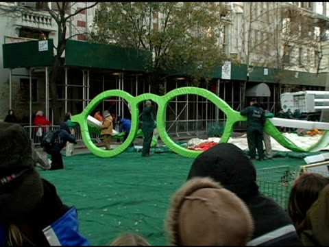 chicken little balloon preparation at the 'inflation eve' macy's 79th annual thanksgiving day parade preparations at 77th street in new york new york... - chicken wire stock videos and b-roll footage