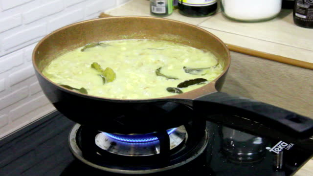 chicken meat in coconut milk boil in pan
