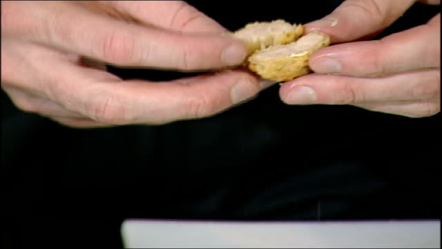 chicken nuggets hygiene allegations london chicken nugget cut in half and squeezed chef gordon ramsey tasting chicken nugget - gordon ramsay stock videos and b-roll footage