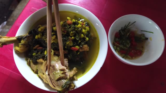chicken stew with herbs sale at co dao market in hai phong - manchuria region stock videos & royalty-free footage