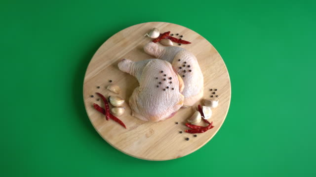chicken thigh on wood board