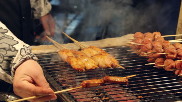 ls chicken wings barbecue in market /xian,shaanxi,china - skewer stock videos & royalty-free footage
