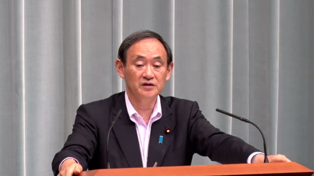 chief cabinet secretary yoshihide suga said he respects the organizer's decision to withdraw the logo on wednesday septmber 2 the top government... - olympic rings stock videos & royalty-free footage