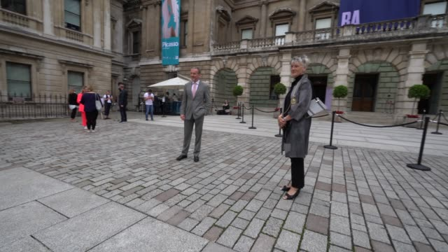 chief executive of the royal academy of arts, alex ruger and president of the royal academy of arts, rebecca salter pose for a photographer in... - art gallery stock videos & royalty-free footage