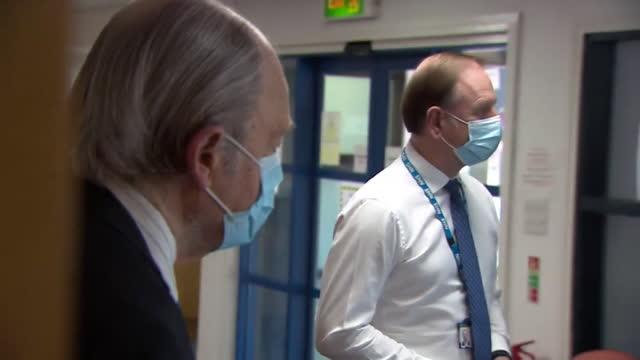 chief executive sir simon stevens holding a meeting whilst observing coronavirus precautions - スキップトン点の映像素材/bロール