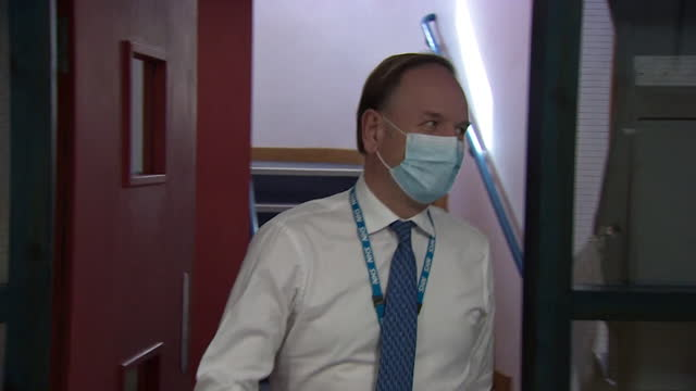 chief executive sir simon stevens visiting a medical facility in skipton - スキップトン点の映像素材/bロール