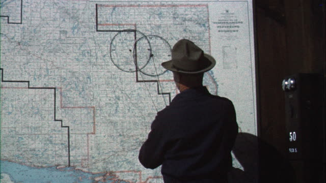 ms chief forest ranger pin pointing on wall map - cartography stock videos & royalty-free footage