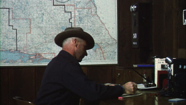 MS Chief forest ranger working at desk