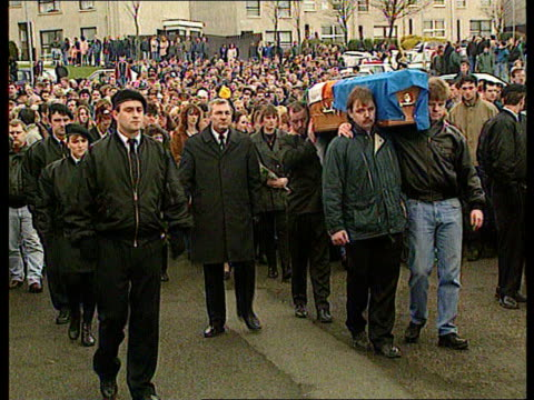 INLA chief Gino Gallagher's funeral Northern Ireland Co Tyrone Moy MS Bullet holes in windows of house LMS Coffin carried towards with INLA escort...