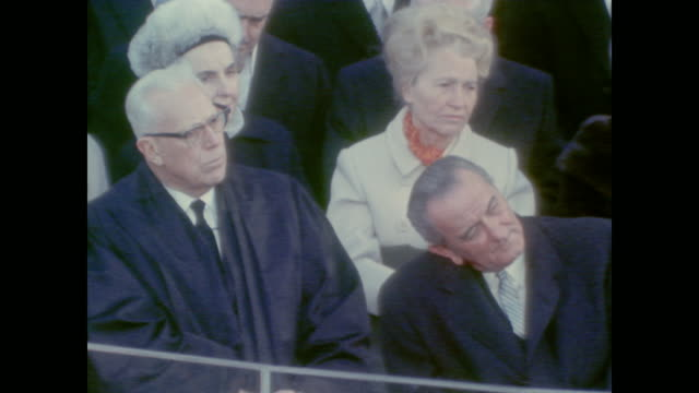 Chief Justice Earl Warren and President Lyndon Johnson watching President Nixon's inauguration from the crowd
