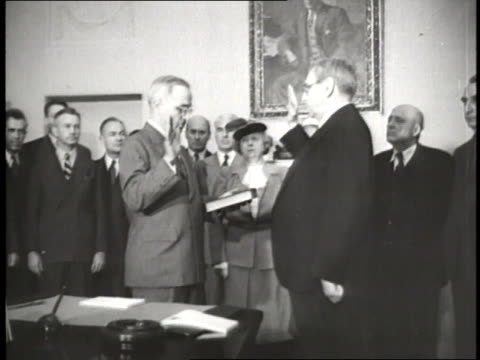 chief justice harlan f. stone gives harry s. truman the oath of office as the 33rd president of the united states. - oath stock videos & royalty-free footage