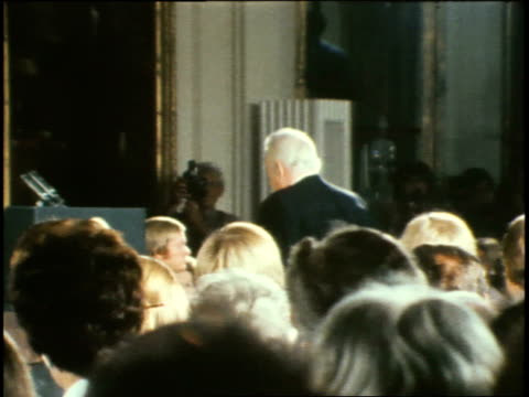 chief justice warren burger walking to podium / vp gerald ford accompanied by wife betty ford enters the room walks onto platform / mr burger swears... - 1974 stock videos and b-roll footage