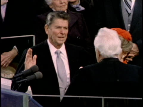 US Chief Justice Warren E Burger administers the Oath of Office to US President Ronald Reagan on January 20 1981