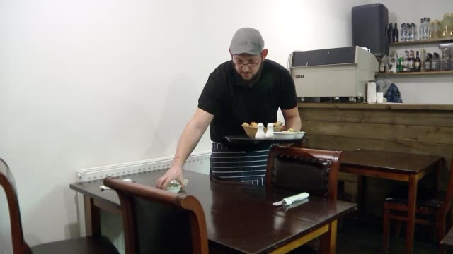 chief keen to bring peace: uk cypriot community views; england: erkan komurculer placing items on table erkan komurculer interview sot mario pishiri... - cheerful stock videos & royalty-free footage