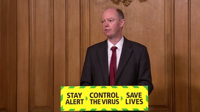 """chief medical officer chris whitty saying """"we have to be realistic, the idea that we can open up everything and keep the coronavirus under control is... - fantasy stock videos & royalty-free footage"""