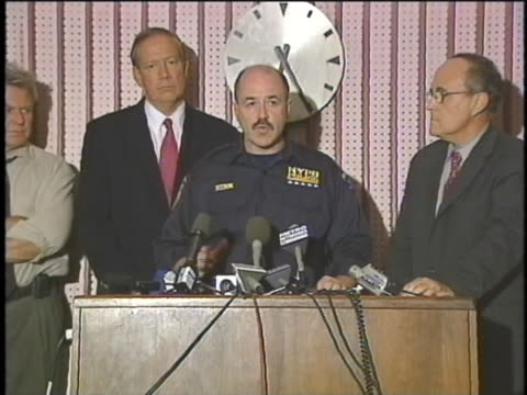 chief of police bernard kerik addresses the actions they are taking for the 9/11 attacks at a press conference - september 11 2001 attacks stock videos & royalty-free footage