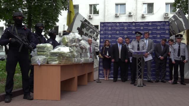 Chief of Ukrainian National Police Serhiy Knyazev speaks next to bags of cocaine seized during a special operation during a pess conference of the...