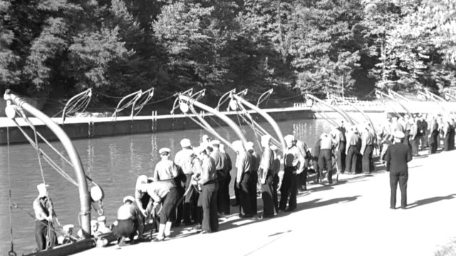a chief petty officer watches as u.s. naval recruits learn how to properly lower lifeboats. - military recruit stock videos & royalty-free footage