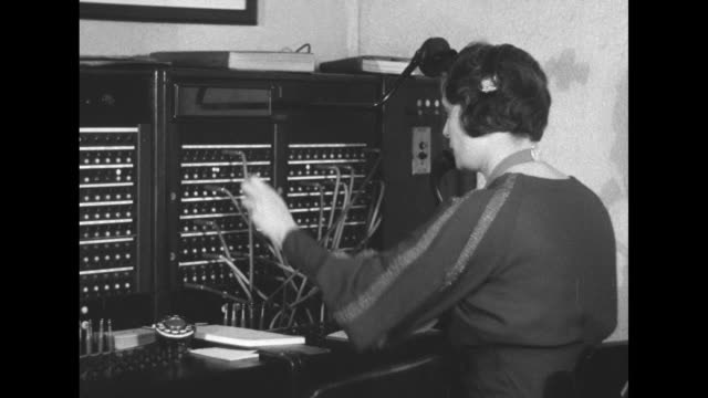 vs chief telegrapher doc smithers at desk / vs telephone operator louise hockmeister at switchboard / franklin roosevelt's secretary stephen early at... - telephone switchboard stock videos and b-roll footage
