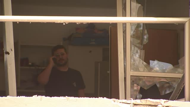 stockvideo's en b-roll-footage met chief warns israel-gaza violence threatens whole region; israel: tel aviv: ext / night various of city skyline as rockets intercepted by iron dome... - israël