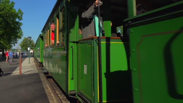chiemsee railway a the station called prien stock on lake, lake chiemsee, chiemgau, bavaria, germany - zug mit dampflokomotive stock-videos und b-roll-filmmaterial