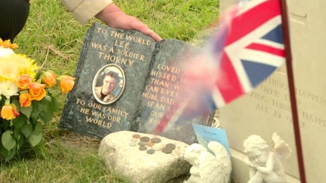 blackpool ext gvs karen and mick thornton tending grave of son and along - ラゲ オマール点の映像素材/bロール