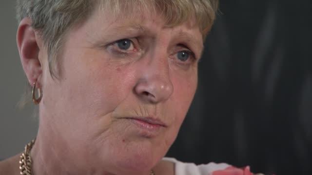 bereaved families' reactions int janice procter interview sot cutaway reporter - ジャッキー ロング点の映像素材/bロール