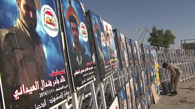 continued unrest in iraq basra posters in street showing images of shiite militia fighters killed fighting sunni extremists - shi'ite islam stock videos & royalty-free footage
