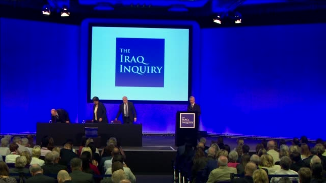 chilcot report published: criticism of military and intelligence community; sir john chilcot along on stage with other members of iraq inquiry team... - weapons of mass destruction stock videos & royalty-free footage