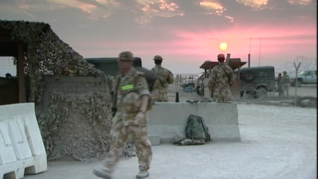 chilcot report published: criticism of military and intelligence community; t14122707 / tx iraq: basra: ext various shots british troops at basra... - iraq stock videos & royalty-free footage