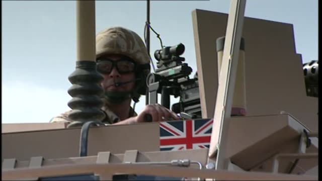 criticism of military and intelligence community t14120727 / tx iraq basra various shots british troops patrolling road in amoured vehicles british... - esercito video stock e b–roll